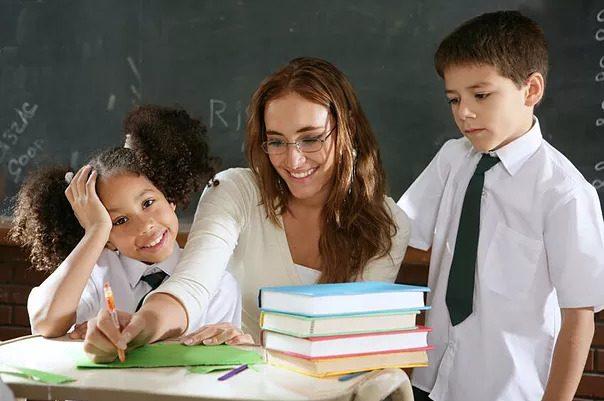 teacher helping class